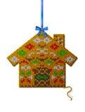 Casa do Natal da tela feita malha com ornamento Imagem de Stock
