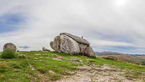 Casa do Penedo, a house built between huge rocks on top of a mountain in Fafe, Portugal. Stock Photography