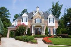 Casa do tijolo e da pedra com flores Imagem de Stock Royalty Free