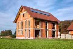 Casa do tijolo sob a construção Imagem de Stock