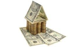 Casa dos dólares e das moedas Fotografia de Stock Royalty Free