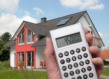 Casa e calculadora Fotografia de Stock