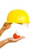 Casa e capacete imagens de stock royalty free