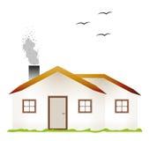 Casa e chaminé de fumo Fotografia de Stock Royalty Free