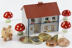 Casa e dinheiro Imagem de Stock