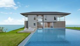 Casa e stagno di spiaggia con la vista del mare nella progettazione moderna Fotografie Stock
