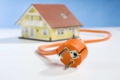Casa e tomada Imagens de Stock