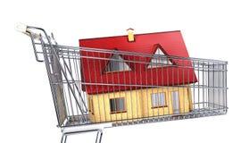Casa em um trole do supermercado Foto de Stock Royalty Free
