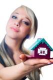 A casa em uma palma Imagem de Stock
