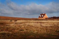 Casa en campo Foto de archivo libre de regalías