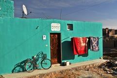 Casa en el oasis Imágenes de archivo libres de regalías