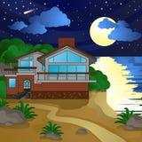 Casa en la playa, noche, claro de luna, cielo estrellado Fotografía de archivo