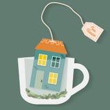 Casa en la taza de té Fotografía de archivo libre de regalías