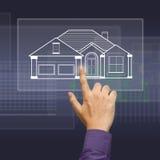 Casa en pantalla táctil Fotos de archivo libres de regalías