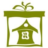 Casa en una caja de cartón. eps10 Fotos de archivo libres de regalías
