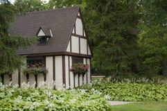 Casa enmarcada de la madera en parque Fotos de archivo libres de regalías