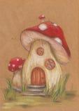 Casa fantástica vermelha do cogumelo fotos de stock
