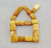 A casa feita da pedra ensolarada do âmbar Imagem de Stock Royalty Free