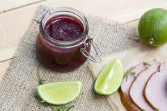 A casa fez o confiture orgânico do doce de cereja, a carne fumado e o cal Fotografia de Stock Royalty Free
