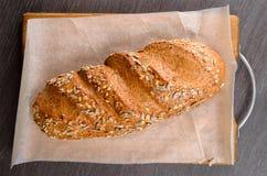 A casa fez o pão na tabela de madeira Fotografia de Stock Royalty Free