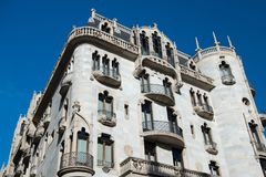 Casa Fuster hotel building on blue sky. Modernist architecture of Barcelona. Design and style. Landmark and sightseeing. Barcelona, Spain - March 30, 2016: Casa stock images