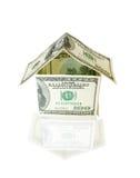 Casa hecha de cuentas de dólar Fotografía de archivo
