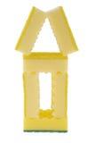 Casa hecha de esponjas amarillas Fotografía de archivo