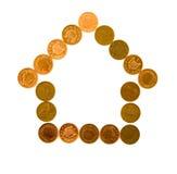 Casa hecha de monedas Fotos de archivo libres de regalías
