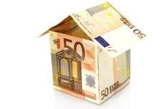 Casa hecha del dinero Foto de archivo libre de regalías