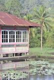 Casa indonesiana tradizionale fra la r Immagini Stock Libere da Diritti