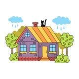 Casa linda del pueblo con el gato Foto de archivo libre de regalías