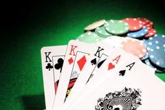 Casa llena K sobre tarjetas del póker de los as Imagen de archivo libre de regalías