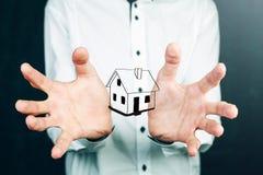 House in human hands. Casa in mano, acquisto nuovo appartamento Royalty Free Stock Image