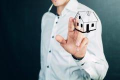 House in human hands. Casa in mano, acquisto nuovo appartamento Stock Photography