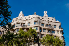 Casa Mila La Pedrera framed by trees at Barcelona Royalty Free Stock Images