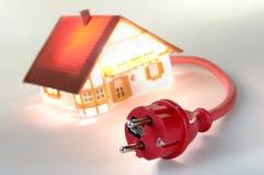 Casa modelo com plugue vermelho Fotografia de Stock Royalty Free