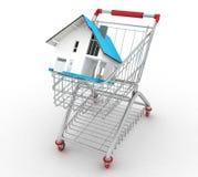 Casa modelo no carrinho de compras Imagens de Stock