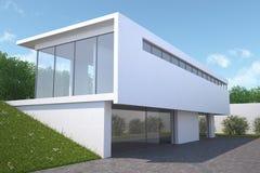 Casa moderna con el jardín, visión exterior. Imagen de archivo libre de regalías