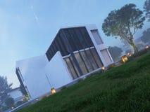 Casa moderna exterior con la iluminación al aire libre en el crepúsculo Foto de archivo