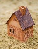 A casa na areia Fotografia de Stock Royalty Free