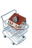 Casa no carrinho de compras Imagens de Stock Royalty Free