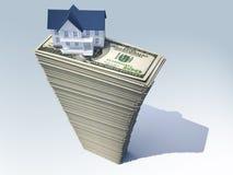 Casa no dinheiro Foto de Stock Royalty Free