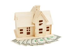 Casa no dinheiro Foto de Stock
