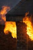 Casa no fogo Imagens de Stock
