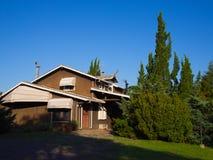 Casa no jardim Foto de Stock Royalty Free