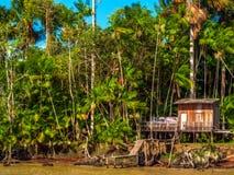 Casa no rio Imagens de Stock