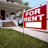 Casa para o sinal do aluguel Fotografia de Stock Royalty Free