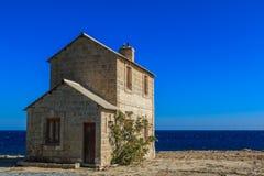 Casa pelo mar Imagem de Stock Royalty Free