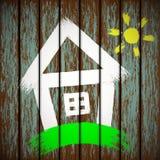 Casa pintada en la cerca Imagenes de archivo