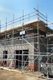 Casa que está sendo construída no retrato Imagens de Stock Royalty Free